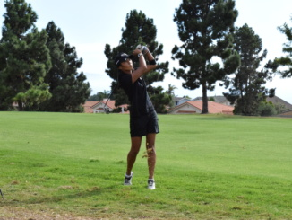 Senior Lexi Nielsen hits a shot out of the rough