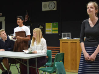 """Drama students (from left to right) Jack Drinker, Toby Kamish, Katie Cochran, and Claire Layden preform an original scene on Tuesday in the drama room for their class.  Their seen, """"Return of Eed"""" sent roars of laughter throughout the audience."""