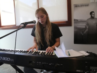 Senior Jane Fishman playing the piano while singing a song made of her own lyrics. Fishman has made several of her own songs that can be found on SoundCloud.