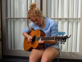 Bradford Michela produced her own song, Jesse James. She has been surrounded by music for as long as she can remember and has been playing music since she was six.