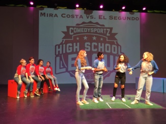Comedy Sportz members juniors Toby Kamish and Dalia Feliciano and seniors Claire Layden and Gabby Guerrero perform their skit on Oct. 3 in the small theather. The team won 34-22 against El Segundo (red.)