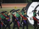 """Color guard and marching band members march in a straight line as they kick off their first performance of the season, """"Trapped in Time"""" on Sept 9 at the first football game of the season."""