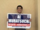 Junior Matthew Gutierrez holds a sign for Al Muratsuchi. He is one of the many Costa students volunteering for campaigns.