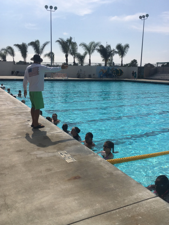 Mr Geller's 5th period PE students utilize the pool for their aquatic workout. They had just practiced swimming breaststroke which was taught to them by Mr Geller.