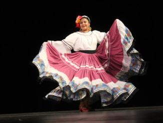 A dancer dances Baile folkloric, traditional Mexican music, courtesy of Angelique Angelastro. She attends Nuestra Raíces, a cultural arts center.