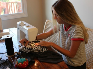 Sophomore Molly Ghiselli works hard at creating new designs for her fellow costumers. Not only does she have local costumers, but she also ships many of her designs across the nation.