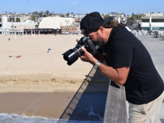 Brent Broza takes pictures on the Hermosa Beach pier. Broza has been taking professional photographs for years.
