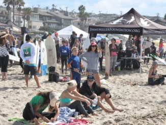 The Jimmy Miller Memorial Foundation had its 12th annual surf fiesta competition.  The Contest Took place in Manhattan Beach and above both competitors and spectators can be seen on the beach.