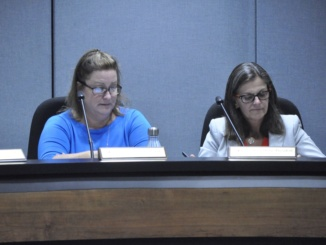 Board members Karen Komatinsky (left) and Ellen Rosenberg (right) discuss the approximate 10% increase in the pass rate for 2016 Advanced Placement examinations over scores from the past three years. This was announced at the Oct. 5 board meeting.