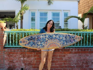 Hermosa Beach artist Katy Jensen showcases one of her recent mosaic art pieces. Jensen creates mosaic art from old surfboards, skateboards, and other objects.