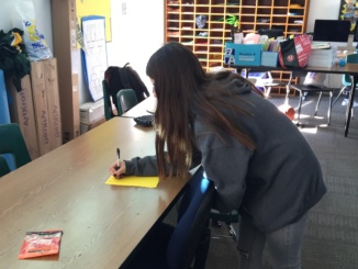 Associated Study Body sophomore representative Daniela Arensdorf helps plan Operation Happiness. ASB collected all of the toys, canned food and gifts that people donated.