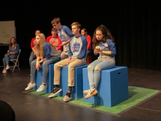 Costa's Comedy Sportz members perform a skit in a match against Palos Verdes. Costa won 33-26.