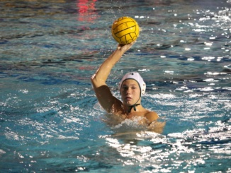 Senior Attacker Christian Thornton prepares to pass to a teammate against Corona del Mar High School.  Mira Costa lost this game and was eliminated from the first round of California Interscholastic Federation (CIF) playoffs.