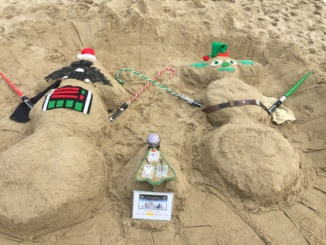 The City of Hermosa Beach hosts its annual Sand Snowman building contest. Participants brought many tools, including shovels, buckets, mittens and Santa hats to help create and decorate their snowmen.