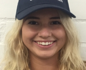 """Headshot of senior Kelly Sidney wearing her """"Make America Great Again"""" hat prior to a Young Republicans Club Meeting."""