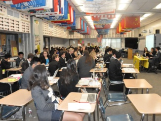 MUN delegates participate in the LAIMUN debate. Both advanced and novice debaters participated in the conference.