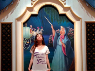 Delphi Borich in front of a painting of the fairy godmother in Cinderella. Borich is apart of the ensemble in the Broadway play Cinderella.