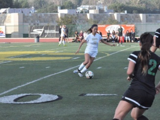 Freshmen Emily Rae dribbling the ball down the field looking for a pass to her teammate in the Mustangs' 1-0 win over South at Waller Stadium on Thursday (Dec. 16). The Mustangs were able to capture a win off a late goal.