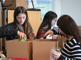ASB students organize cans for operation happiness. Operation Happiness started on Nov. 29.