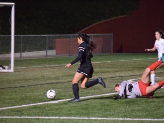 Mira Costa's senior midfielder Viviana Villacorta dribbles past Redondo defenders on Friday night, in Costa's 6-2 defeat on the road. and finds the back of the net. The Mustangs were unable to stage a comeback after Villacorta's goal, handing them its third straight loss.