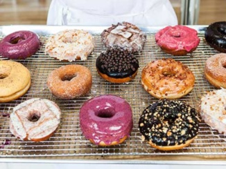 This photo displays Blue Star's donut arrangement at their Portland Oregon location. The donut shop offered a variety of one-of-a-kind flavors for customers to enjoy. Courtesy of The New Potato.