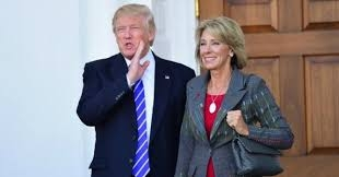 President Donald Trump stood with Betsy DeVos after a meeting at Trump National Golf Club Bedminster in New Jersey on November 19, 2016. She has now been officially been chosen as his Secretary of Education.