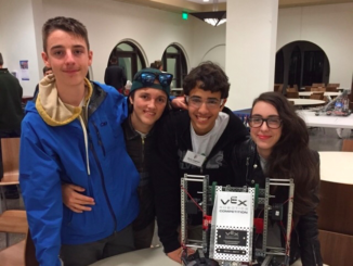 Freshman Ethan Ferguson (left), sophomore Cruz Del Valle, freshman Kevin Sabbe and sophomore Genevieve Paraszczuk competed at the San Diego robotics competition last weekend, where the team's robot (right) won first place. Courtesy of Genevieve Paraszczuk