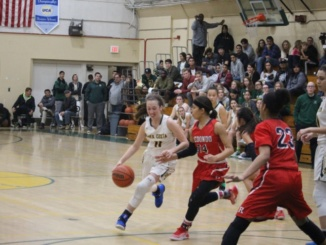 Mira Costa Junior Haley Herdman maneuvers around her Redondo Beach opponent at the Mira Costa Girls Varsity Basketball game on Tuesday night. The game resulted in a decisive Redondo Union victory, despite many offensive efforts by Herdman and her teammates.