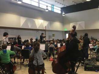 Students attentively watch Peter Park as he directs the Honors Strings program students. The practices take place every Tuesday in the Mira Costa band room.