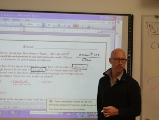 Mira Costa teacher Trevor Oystrick instructs his Advanced Placement Environmental Sciences class on the flipped-classroom technique.