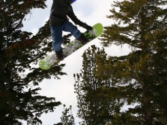 Junior snowboarder John Pogue, soars through the air on his snowboard while he is training. Pogue dreams of one day becoming a professional snowboarder.  This photo is curtesy of the Pogue family.