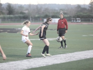 Junior midfielder Genevieve Watkins receives a ball towards the sideline in the Mustang's 2-1 loss to Redlands East Valley on the road Thursday (Feb. 16). The Mustangs conclude its season with its loss to Redlands East Valley in the California Interscholastic Federation (C.I.F.) playoffs.