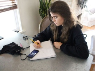 "Junior Maeve Tomalty sketches designs for her clothing company Gémaux. She describes the style as being ""glam punk"" and items will be available for purchase in the upcoming months."