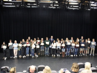 Students hold up their awards at the PSTA Student Recognition.  Dr. Dale had just presented them with the awards, along with a gift certificate.
