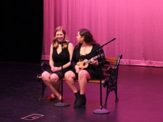 """Sophomores Danielle Healy (left) and Sofia Aguire perform their song, """"The Awkward Duet"""", while Aguire plays the ukelele at the annual Drama AIDS Benefit Show on Feb. 7 in the small theatre. (Sarah Toomey/La Vista)"""