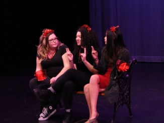 Sophomores Sophie Boylan, Stephanie Sala and Madison Reinart perform in the Drama Department's annual AIDS Benefit show. The AIDS Benefit show took place in the small theater. (Sarah Toomey/La Vista)