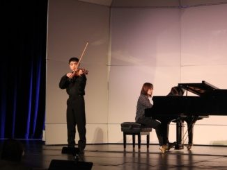 Violinist Eric Mei places first in the ninth grade division in the annual Rotary Solo Competition Finals. Band and orchestra performers received placings throughout the competition. (Josh Marer/La Vista)