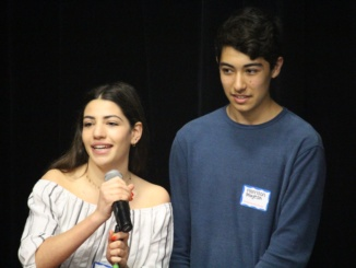 Juniors Harrison Mayesh (right) and Hannah Zaslansky (left) announce the first speaker, Ronald Clinton, and introduce the topic of their TEDx talk, blessings in disguise on March 22.