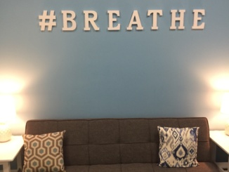 "When a student walks into Costa's stress room, they see a couch with the sign ""#breathe"" above it in order to remind students that they can relax and clear their minds while they are in the room. School nurse Hedy Deck believed that this calm atmosphere would permit students to de-stress and freshen their minds before returning to class."