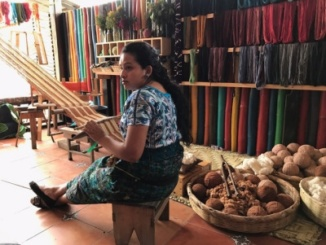 A Guatemalan woman hand-weaving fabric and strings together during the Costa students' Cinematic Arts trip from Feb. 19th-Feb. 26th to Antigua, Guatemala. The Costa students observed many aspects of Guatemalan life and are currently editing together the filmed they shot to finish their four documentaries.