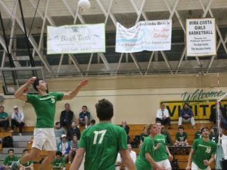 Senior Kevin Pinkerton serves the ball with his famous jump serve in a home game against the Palos Verdes sea kings  on March 28. Pinkerton had a total of eight points in this game.