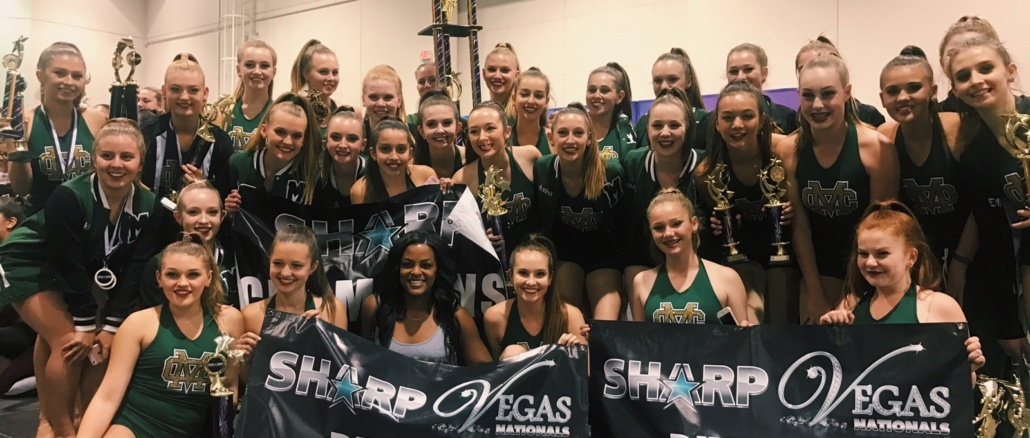 "Mira Costa's varsity dance team hold a trophy and signs labeling Mira Costa as ""division winners"" on Saturday at the SHARP International Las Vegas Nationals. Dance placed first overall, placing first in lyrical and jazz and second in hip hop."