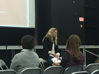 Therapist Leah Neihaus introduces herself by talking about her experiences with teens and stress at the South Bay Families Conncted Teen Panel at Manhattan Beach Middle School on April 19. The audience was given information on how to understand teens and stress.