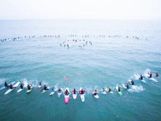 Hundreds gathered on April 17 to paddle out to the Manhattan Beach pier in honor of Sandro Mcilroy. Students organized the event to honor Sandro's memory.