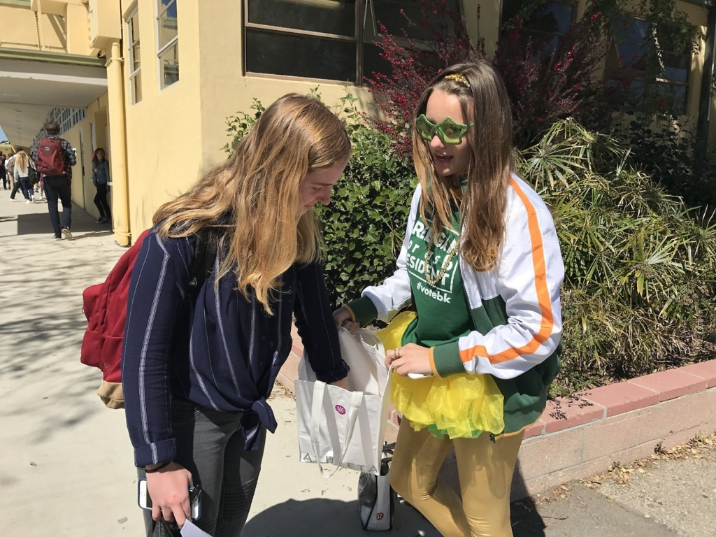 lavistamedia Junior ASB vice president Breegan Knudson(right), running for ASB president, campaigns to Camille Caflisch(left) in the Mustang Mall between passing periods. She designed t-shirts, created pins, hung up posters through out school, and handed out candy to students when she campaigned.
