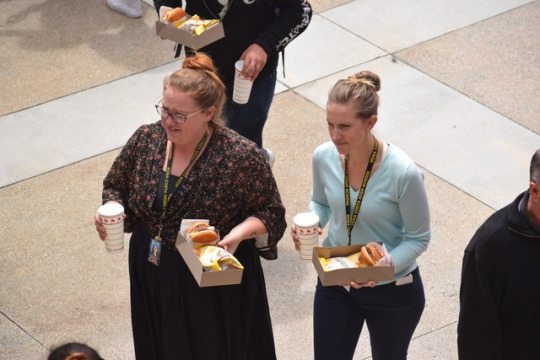 Costa English teachers Ms. Hutchinson and Ms. Gabbert walk to their classrooms after receiving a free In 'n Out lunch from the honor roll lunch today in front of the admin building.  Costa offered a free lunch to anyone who was on honor roll last semester.