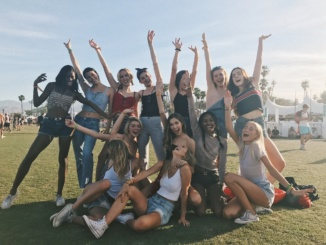Girls pose outside the Main Stage at the 2017 Coachella Music Festival. The festival happens yearly and attracts music and fashion lovers alike.