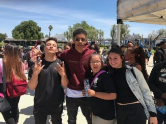 Photo reproduced with permission of Olivia Wymbs Korkin, Pacheco and Wymbs pose for a picture after their performance at Locke High School on April 28. They got this opportunity through a nonprofit organization called The School Tour Performances, which encourages kids interested in being in the entertainment industry to achieve their goals.