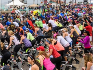 Participants in the 2016 Tour de Pier ride hundreds of stationary exercise bikes while instructors keep them motivated at the Manhattan Beach Pier. To be able to take the cycling class, participants must fundraise $600 or more for cancer charities.