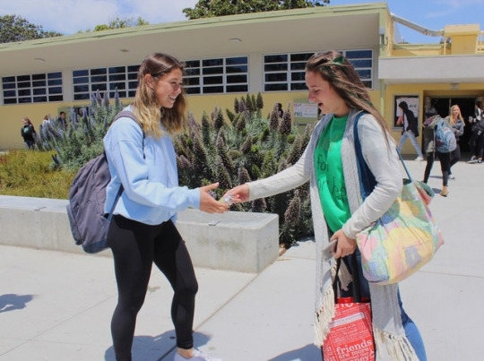 Sophomore Ava Van't Hof passes out candy to various students during lunch time in attempt the win the junior representative position in ASB for next year. She also made stickers and put up posters around the school